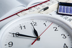 Business stil life with clockface Stock Image