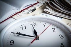 Business stil life with clockface Stock Photos