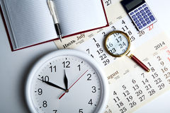 Business stil life with clockface Royalty Free Stock Image