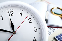 Business stil life with clockface Stock Photography