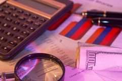 Business still life. Business chart, pen, Us dollars and calculator, shallow dof Stock Image