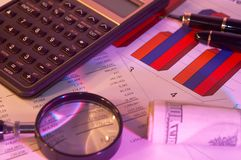 Business still life. Business chart, pen, Us dollars and calculator, shallow dof Royalty Free Stock Photography