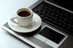 Business still-life 2. Cup of black coffee on a laptop business concept stock image