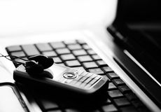 Business still life. Laptop with a mobile phone and ear-phones Stock Photography