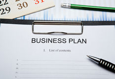 Business still life with business plan Royalty Free Stock Photos