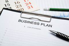 Business still life with business plan Royalty Free Stock Photo
