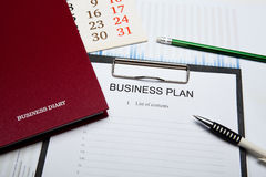 Business still life with business plan Stock Photo
