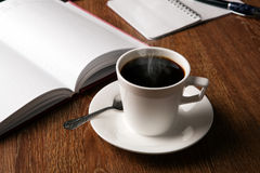 Business still life with cup of black coffee Stock Photography