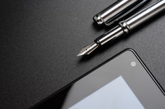 Laptop, tablet, fountain pen Stock Photo