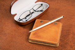 Business  still-life with a pen and glasses Royalty Free Stock Photo