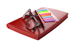 Business still-life of a pen, stickers, spectacles and diary Stock Photography