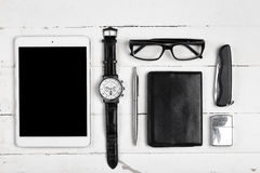 Business still-life with tablet computer glasses and cigarette l. Ighter on white boards Stock Photography