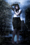 Business Storm. Art Design Photo Of A Business Woman On Dark City Street Caught In The Pouring Rain Of A Business Storm In A Metaphor Of Insurance Cover And Royalty Free Stock Photo