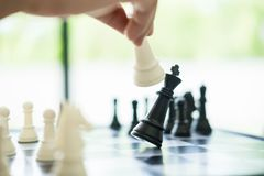 Business Strategic Formation In The Chess Game King Is Checkmate Royalty Free Stock Image
