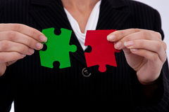 Business strategy. Concept with puzzle pieces and a businesswoman Royalty Free Stock Photo