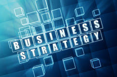 Business strategy in blue glass blocks. Business strategy text in 3d blue glass cubes with white letters Stock Photos