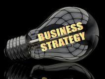 Business Strategy. Lightbulb on black background with text in it. 3d render illustration Royalty Free Stock Photos