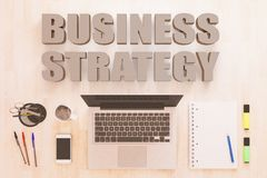 Business Strategy. Text concept with notebook computer, smartphone, notebook and pens on wooden desktop. 3D render illustration Royalty Free Stock Photography