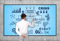Business strategy. Businessman pointing to blasma panel with business strategy Stock Images