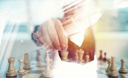 Business strategy with chess game and handshaking business person in office. concept of challenge and tactic. double. Business strategy with chess game and Stock Image