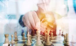 Business strategy with chess game and handshaking business person in office. concept of challenge and tactic. double. Business strategy with chess game and Stock Photo