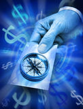 Business Strategy Compass Money. A businessman holding a card with a compass and a blue abstract background with dollar symbols Stock Photo