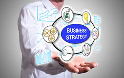 Business strategy concept above a human hand Stock Images