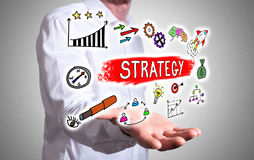 Business strategy concept above a human hand Stock Image