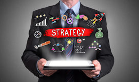 Business strategy concept appearing above a tablet Royalty Free Stock Photo
