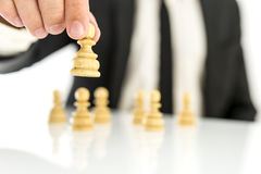 Business strategy concept. Businessman moving pawn chess figures. Concept of business strategy Royalty Free Stock Images