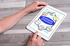 Business strategy concept on a tablet. Business strategy concept shown on a tablet used by a woman Stock Photos