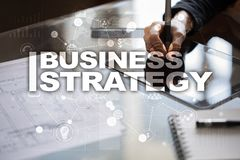 Business strategy concept on the virtual screen. royalty free stock image