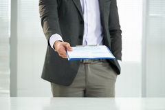 Business strategy. Cropped image of a businessman holding a clipboard with the company�s strategy on the foreground Stock Photography