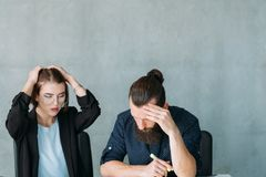 Business strategy failure troubleshooting meeting. Business strategy failure. Troubleshooting meeting. Concerned team colleagues thinking hard. Copy space royalty free stock photography