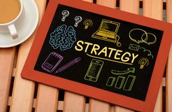 Business Strategy graphics and Icons on chalkboard Stock Images