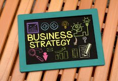 Business Strategy idea Drawing on Slate with icons.  Royalty Free Stock Image