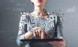 Business strategy ideas with woman using a tablet stock photo
