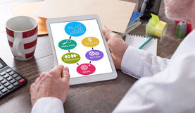 Business strategy improvement concept on a tablet Stock Photos