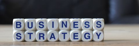 Business strategy. Letters cube wordings on wood table Stock Photo