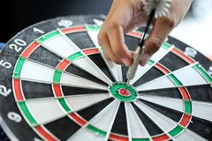 Business strategy planning success target goals,Businessman hold. Ing dart push on target Stock Photos