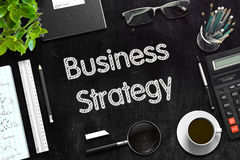 Business Strategy - Text on Black Chalkboard. 3D Rendering. Business Strategy Handwritten on Black Chalkboard. Top View Composition with Black Chalkboard with Stock Images