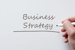 Business strategy written on whiteboard royalty free stock images