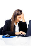 Business stress. Stressed businesswoman is frustrated and overworked at her desk and computer isolated on white background Stock Images