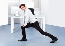 Business stretching Stock Photography