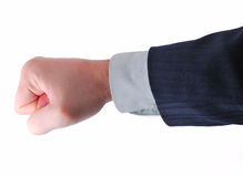 Business strike. A fist isolated on white Royalty Free Stock Photography