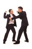 Business struggle. Struggle between two businessmen. isolated on white royalty free stock photos
