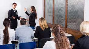 Business students in classroom Royalty Free Stock Photo