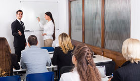 Business students in classroom Royalty Free Stock Photography