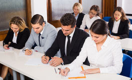 Business students in classroom Stock Images