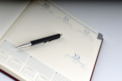 Business stuff, pen and agenda. Image of weekly planner and pen Royalty Free Stock Photo
